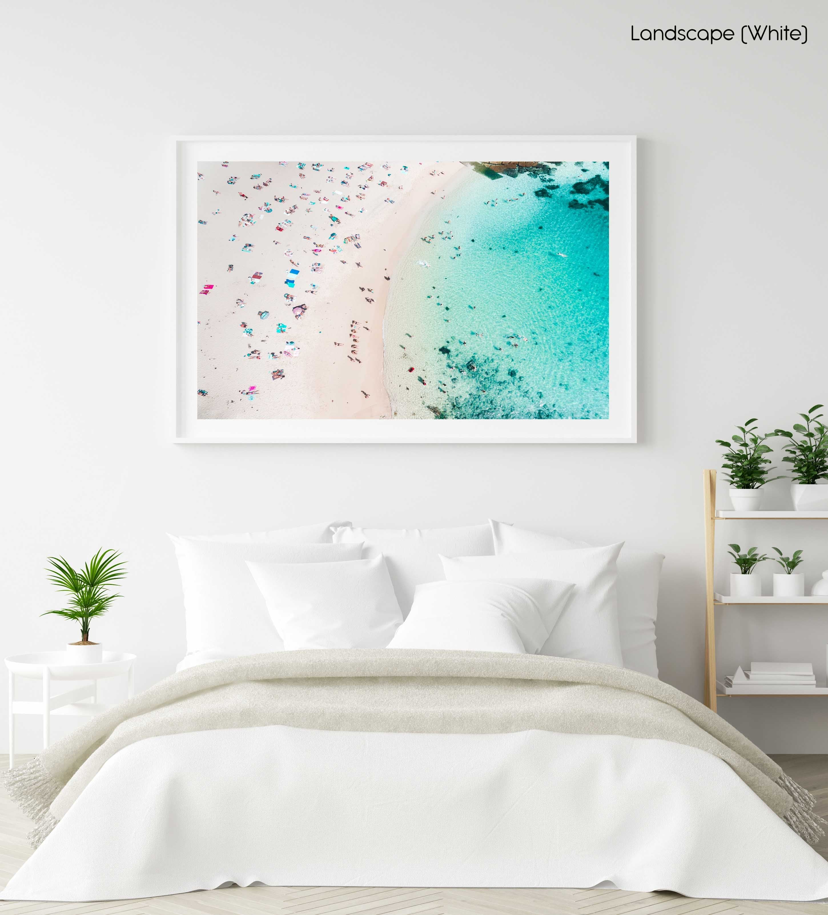 Summers day at Shelly Beach with people tanning and swimming in blue water in Sydney in a white fine art frame