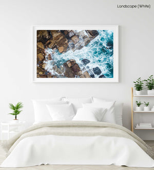 Water crashing from sea into rocks along Sydney coast in a white fine art frame
