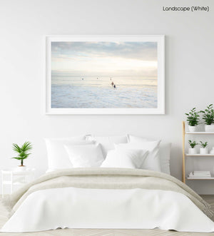 Neutral surfers lined up in water for sunrise surf on Manly Beach Sydney in a white fine art frame