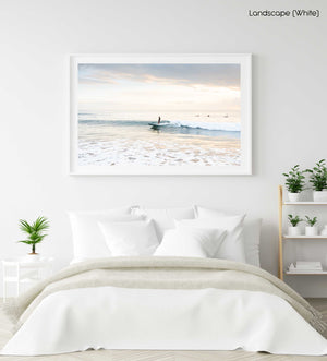 Girl surfing on a wave during sunrise on Manly Beach in Sydney in a white fine art frame