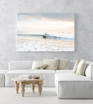 Girl surfing on a wave during sunrise on Manly Beach in Sydney in an acrylic/perspex frame