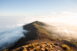 Mist rolling over cape town and signal hill from lions head