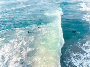 Wave crashing over surfer from above in Sandy Bay beach Cape Town