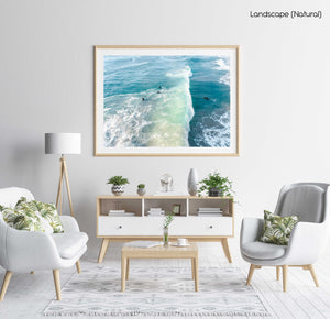 Wave crashing over surfer from above in Sandy Bay beach Cape Town in a white fine art frame
