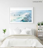 Aerial of bodyboarder surfing a wave amongst other surfers in Sandy Bay Cape Town in a white fine art frame