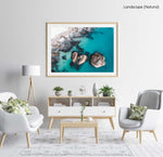 Aerial of three big boulders in blue Atlantic Sea in Clifton Cape Town in a natural fine art frame