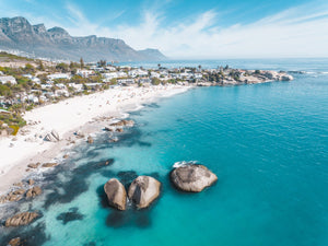 Aerial of Clifton Beach with blue water and sky on a summer day in Cape Town