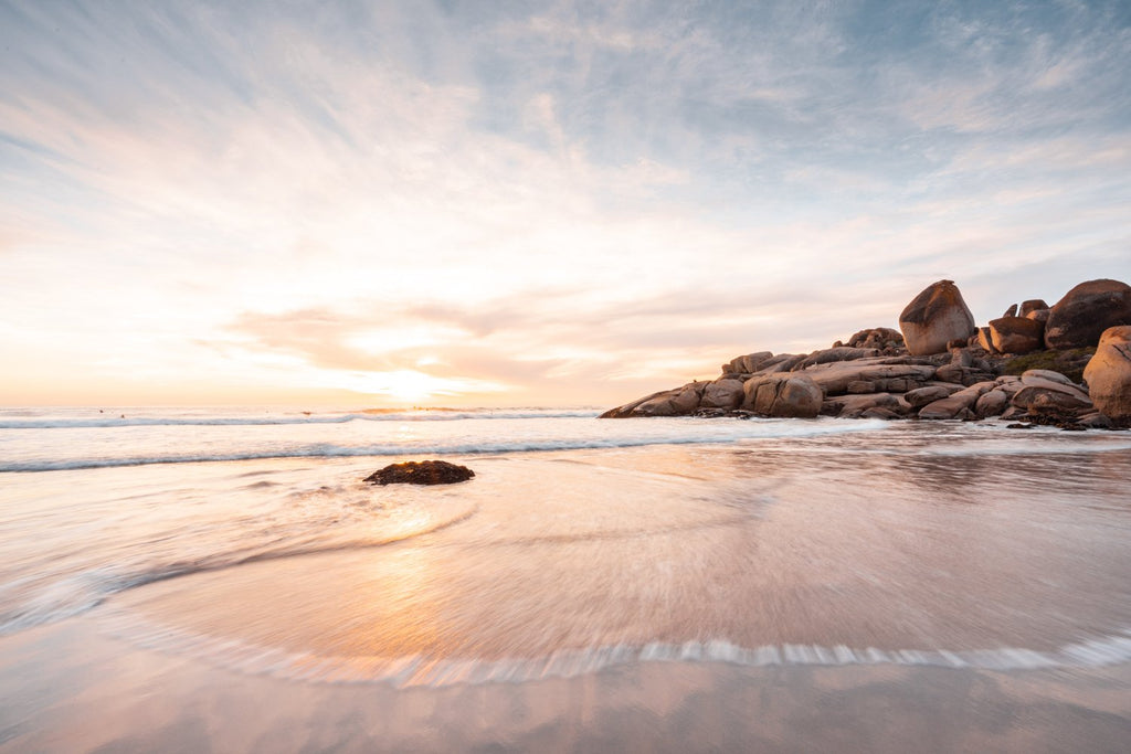 Long exposure of waves and sunset at Llandudno Beach Cape Town