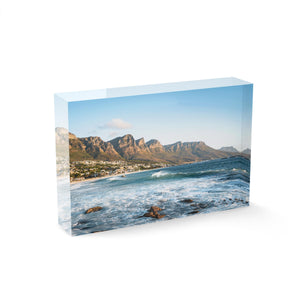 Windy offshore wave at Camps Bay Beach with Twelve Apostles mountains