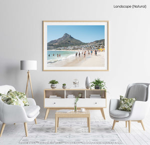 People swimming and playing on Camps Bay Beach below the lions head in a natural fine art frame