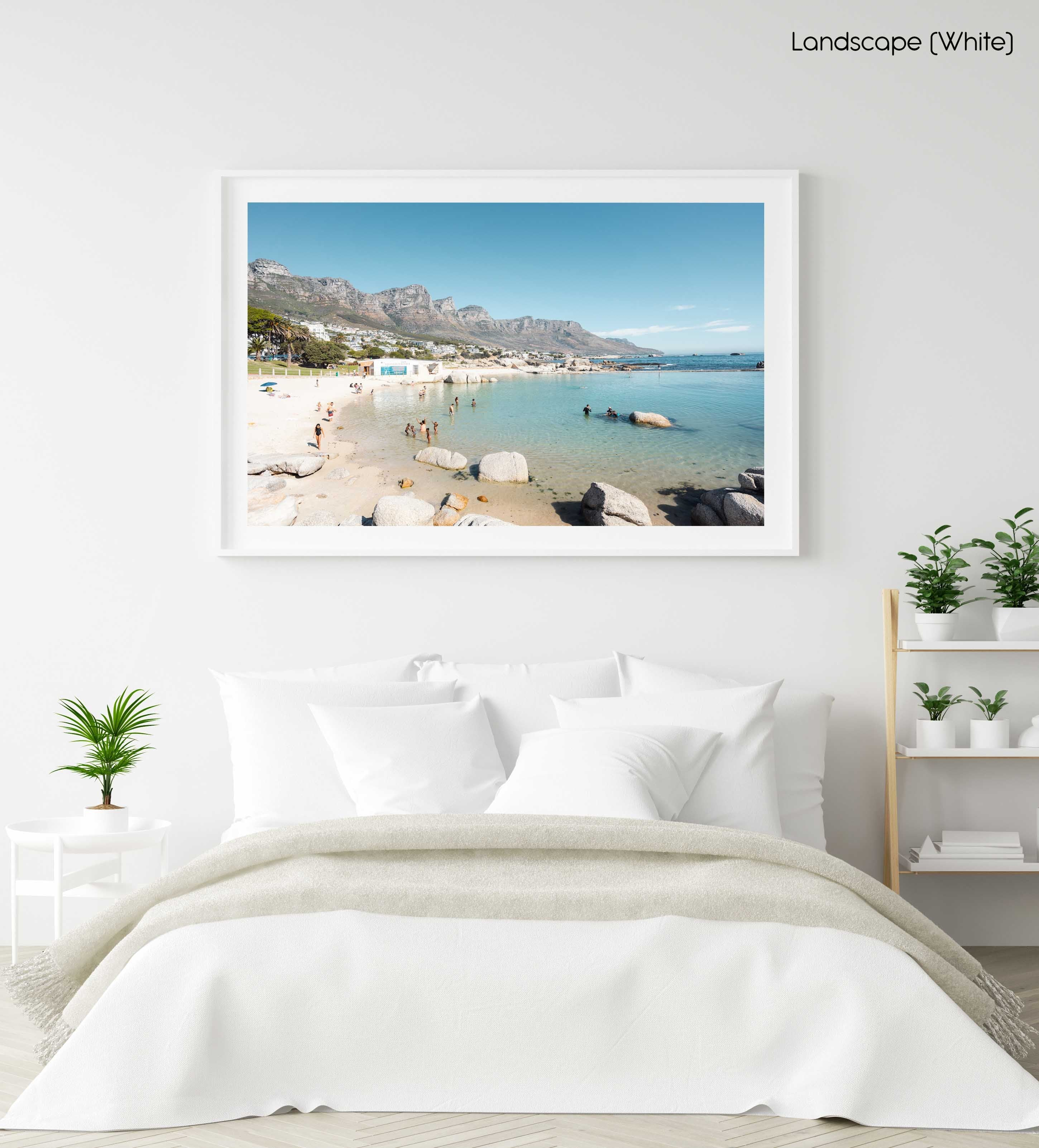 People swimming in the blue tidal pool in Camps Bay Cape Town in a white fine art frame