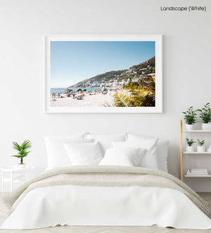Palm tree and people sunbathing at Clifton fourth beach in Cape Town in a white fine art frame