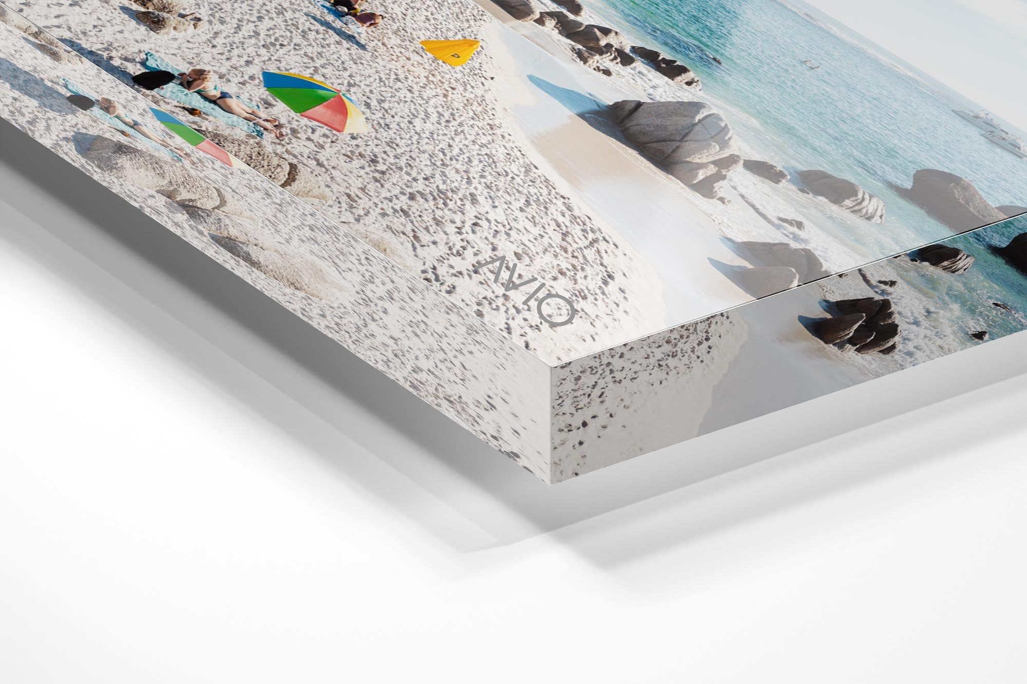 People tanning along the coast of Clifton in Cape Town in an acrylic/perspex frame