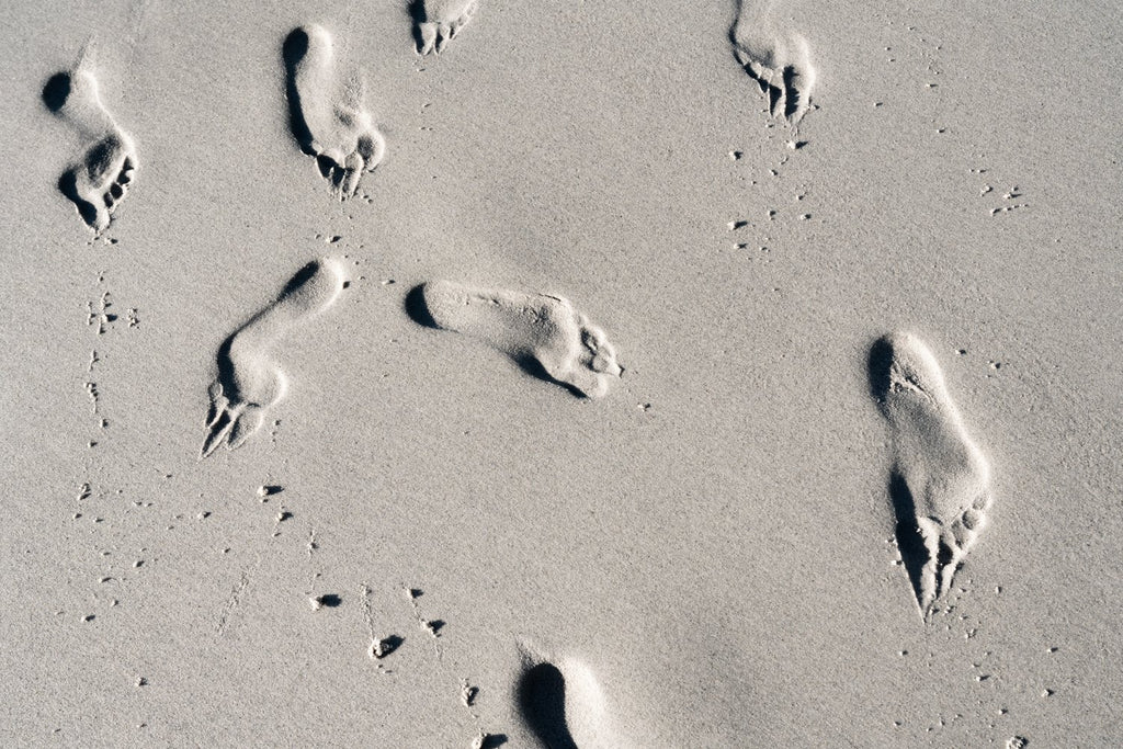 Sandy footprints on Clifton Beach in Cape Town