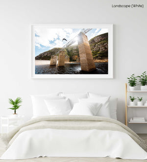 Boy doing a backflip off a bridge at Hermanus dams South Africa in a white fine art frame