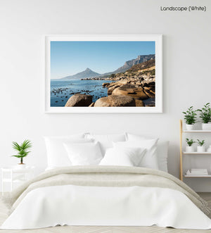 Lions Head seen from Oudekraal's blue water and rocks in a white fine art frame