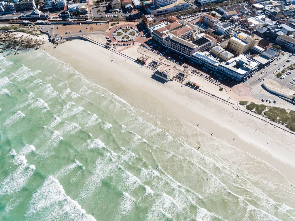 Aerial of Muizenberg beach and its waves in Cape Town