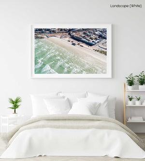 Aerial of Muizenberg beach and its waves in Cape Town in a white fine art frame