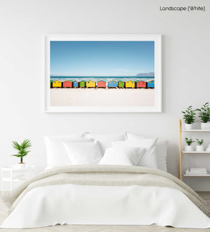 A row of colorful huts along Muizenberg Beach in a white fine art frame