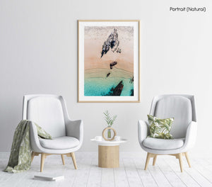 Aerial of a jagged rock along Kalk Bay coast in a natural fine art frame