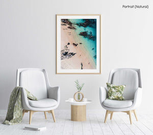 Aerial of kids playing on a beach in Kalk Bay in a natural fine art frame