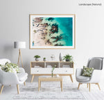 Bright turquoise blue water and rocks along Kalk Bays beach in a natural fine art frame