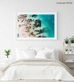 Bright turquoise blue water and rocks along Kalk Bays beach in a white fine art frame