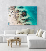 Bright turquoise blue water and rocks along Kalk Bays beach in an acrylic/perspex frame
