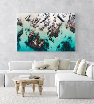Rock slabs along the coast of Kalk Bay in blue calm water in a white fine art frame