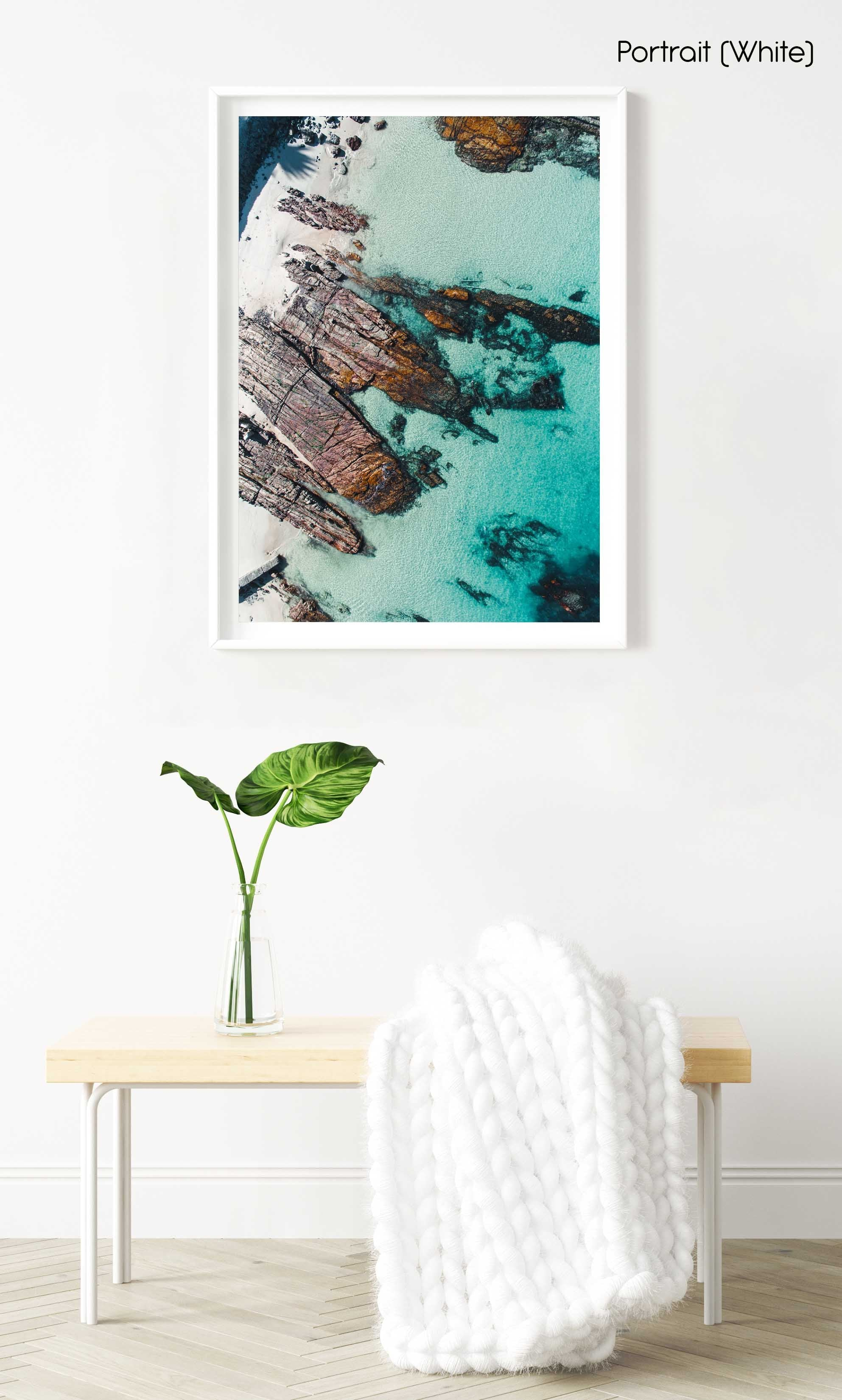 Rock slabs along the coast of Kalk Bay in blue water in a white fine art frame