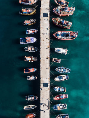 Aerial of boats docked in dark water at Kalk Bay harbour
