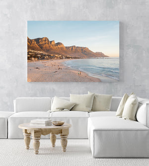 People walking along Camps Bay beach during an orange sunset in an acrylic/perspex frame