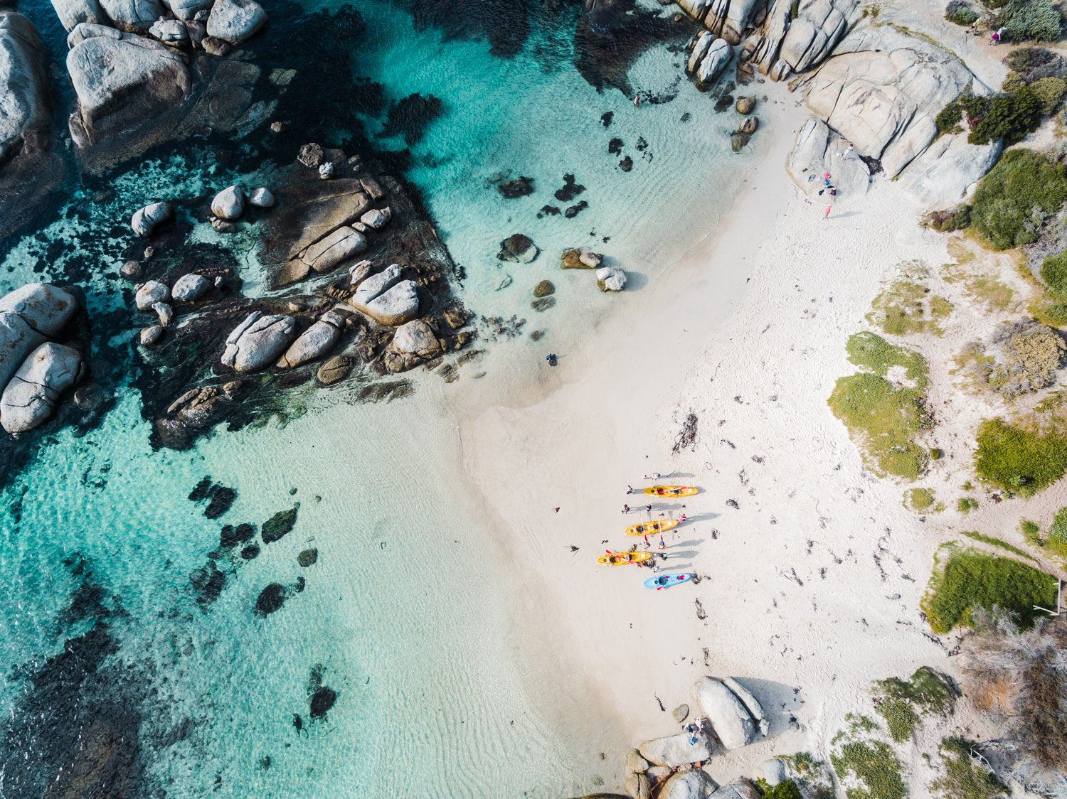 Kayaks on Windmill Beach in Simons Town from above