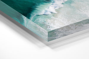 Big wave breaking in dark turquoise Noordhoek Beach from the air in an acrylic/perspex frame