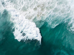 Large wave crashing at Noordhoek beach seen from above