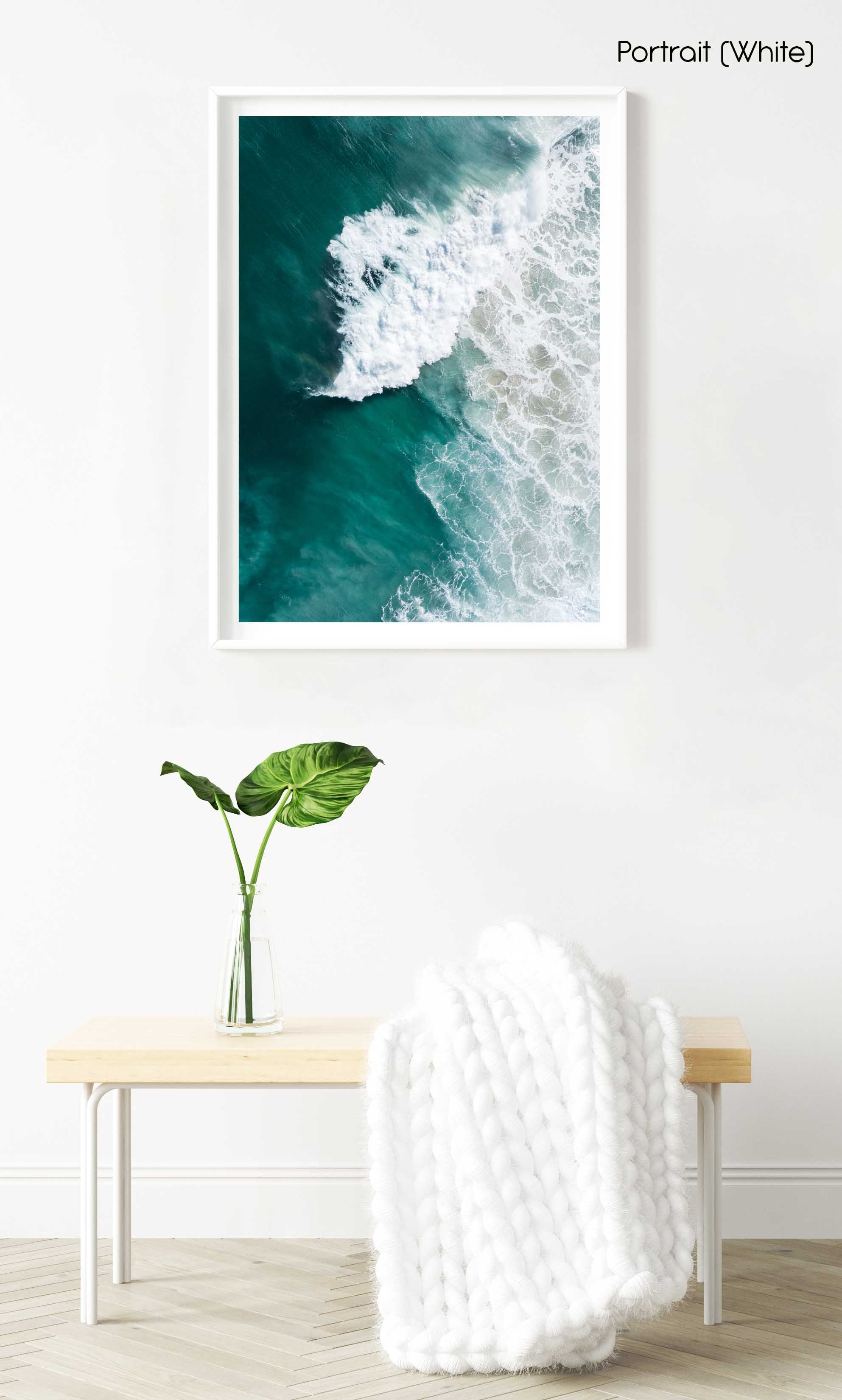 Large wave crashing at Noordhoek beach seen from above in a white fine art frame