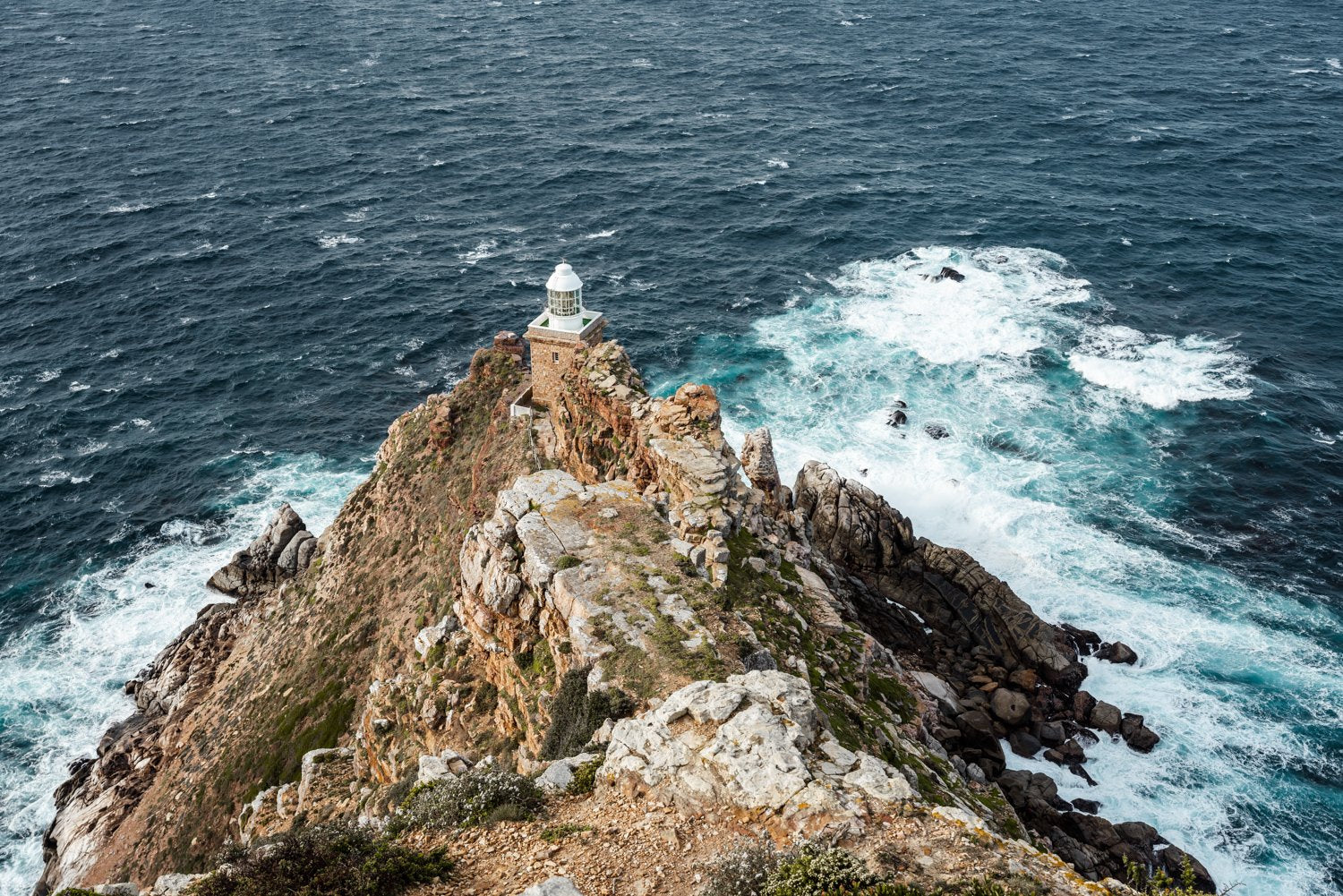 Lighthouse at Cape Point with windy ocean