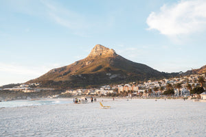 Lions Head glowing from sunset at Camps Bay beach