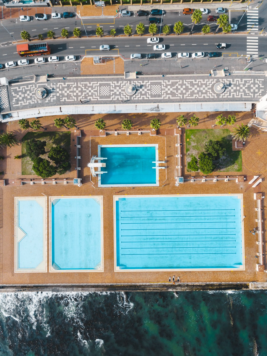 Aerial topdown of promenade pools and cars at Sea Point Cape Town
