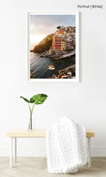 Docked boats and colorful buildings at sunset in Riomaggiore Cinque Terre in a white fine art frame