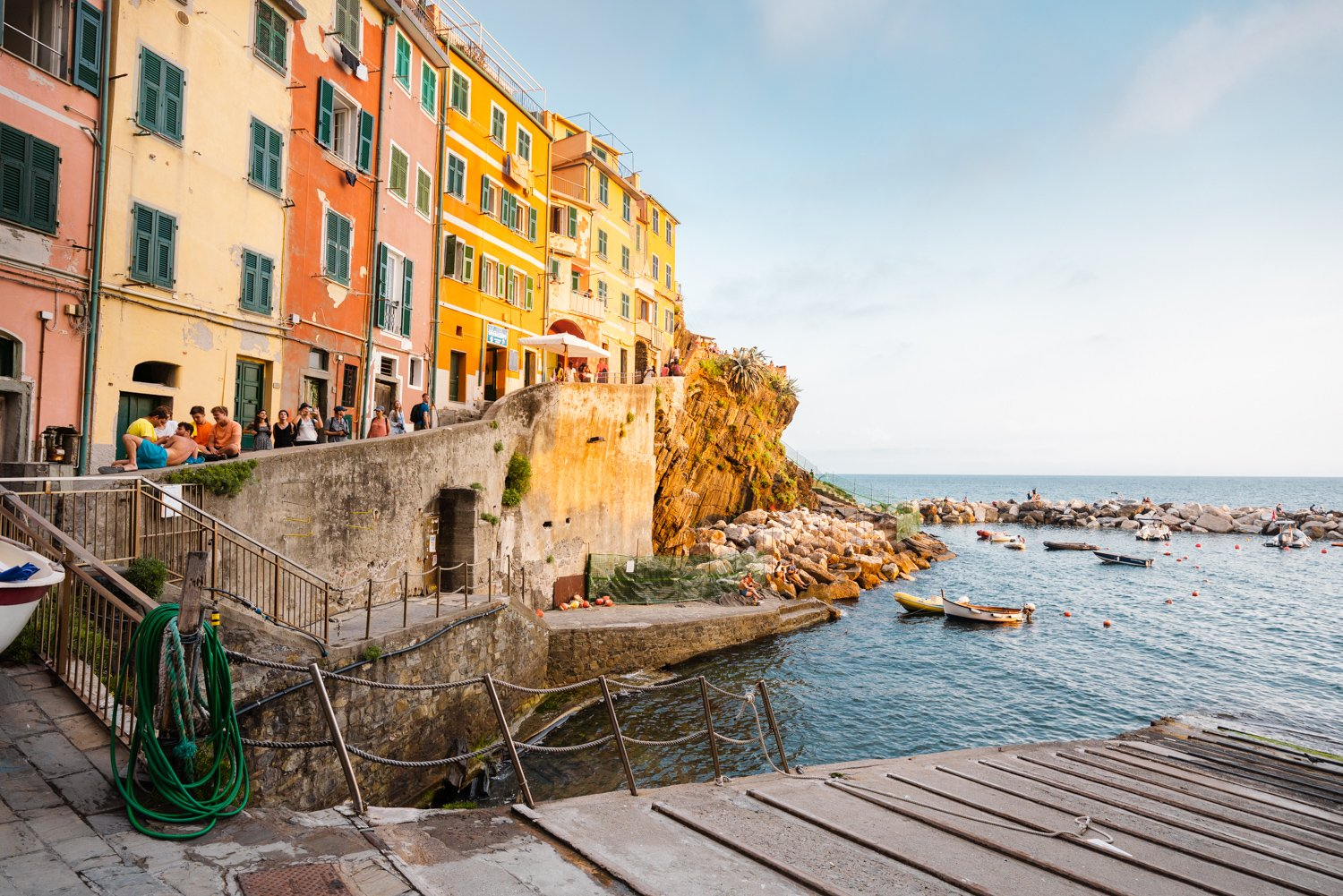 Slipway and people walking along ocean in Riomaggiore