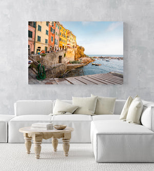 Slipway and people walking along ocean in Riomaggiore in an acrylic/perspex frame