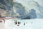 People swimming at castle and hills of Monterosso in Cinque Terre