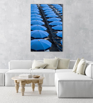 Blue umbrellas and beach chairs lined up in Italy in an acrylic/perspex frame