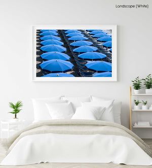 Rows of blue umbrellas and chairs on italian beach in a white fine art frame