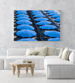 Rows of blue umbrellas and chairs on italian beach in an acrylic/perspex frame
