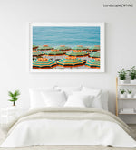 Rows of striped orange umbrellas and turquoise sea in Cinque Terre in a white fine art frame