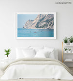 Four people paddling on board alongside mountains in Cinque Terre in a white fine art frame