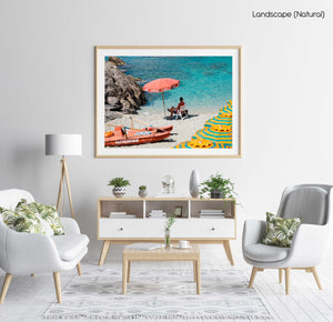 Italian lifeguard sitting under umbrella at blue water on Monterosso Beach in a natural fine art frame