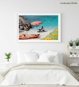 Italian lifeguard sitting under umbrella at blue water on Monterosso Beach in a white fine art frame